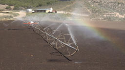 Irrigation sprinklers farm rainbow fast motion 4K 002 Footage