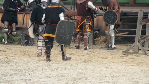 Actors in medieval suits having break during historical movie shoot, reenactment Footage