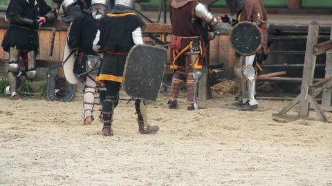 Actors in medieval suits having break during historical movie shoot, reenactment Footage