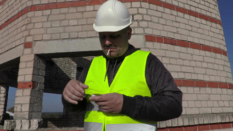 Worker trying to ignite cigarette Footage