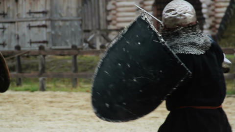 Reenactment of medieval martial arts tournament by actors wearing armor suits Footage