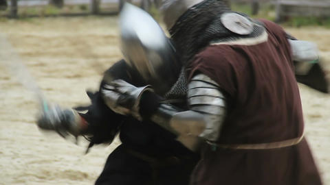 Fierce sword fight, two strong men showing their martial skills on battle field Live Action
