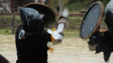 Two men reenacting fight between medieval knights, enjoying martial art hobby Live Action