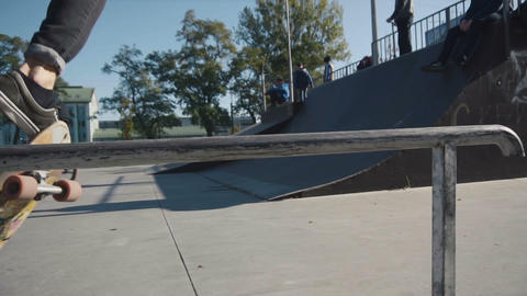 Young man does slide trick on skateboard Footage