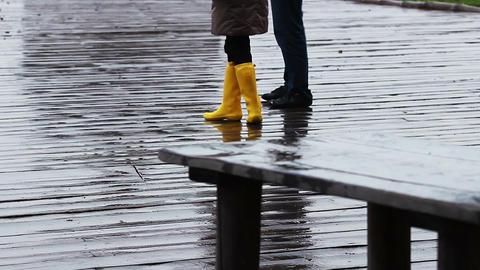 Romantic couple walking in the rain in a beautiful location. Secret of love Footage
