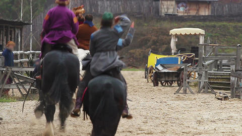 Riders on pedigreed horses arrive in medieval town. Historical reenactment Live Action