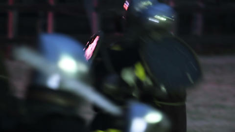 Warriors in knight armor fighting on battlefield, reenactment of medieval war Footage
