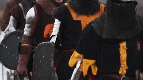 Medieval squad goes into battle. Group of knights marching. Fight reenactment Footage