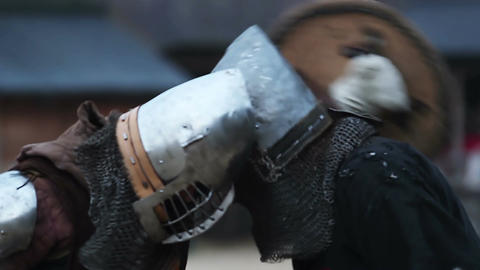 Two brave men reenacting a duel between strong and fearless knights. Middle Ages Footage