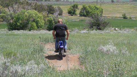 Man on small dirt bike P HD 0855 Footage
