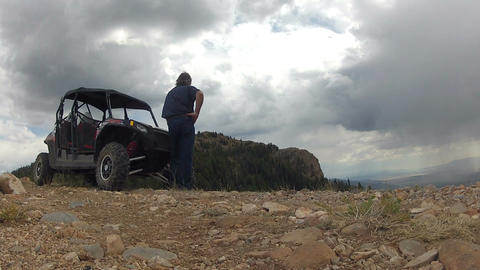 Man on top of mountain sport four wheel drive vehicle HD 007 Footage