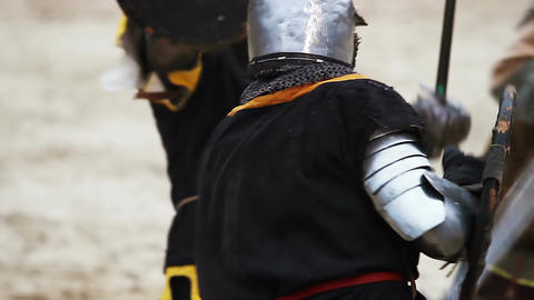 Medieval tournament and competition between two strong knights with steel swords Footage
