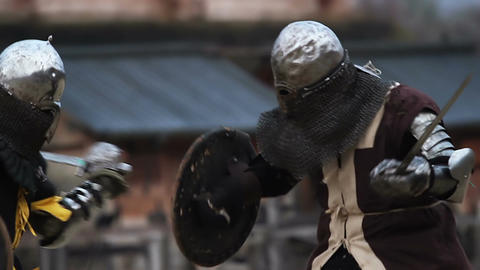 Vicious sword fight between two medieval warriors and opponents. Middle Ages Footage