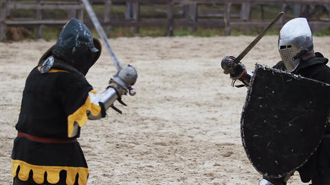Beginning of fierce battle between two men dressed in vintage medieval clothes Live Action
