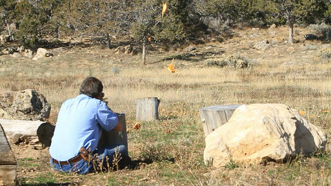 Man shooting pumpkin slow P HD 8063 Live Action
