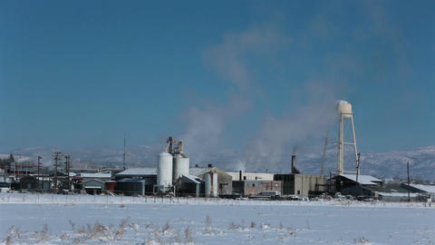 Manufacturing meat processing plant winter smoke HD 0202 Footage