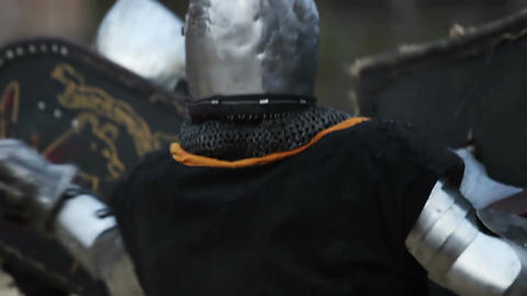 Fierce battle between two knights in steel armor, medieval tournament in action Live Action