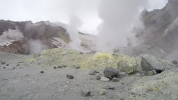 Smoking sulfuric fumarole in crater active volcano Footage