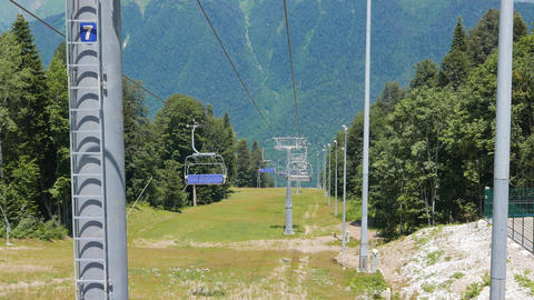 Chairlift above ski slope. Sochi, Russia Live Action