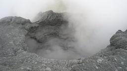 Volcanic activity on Kamchatka - boiling thermal mud pot in crater of active vol Footage