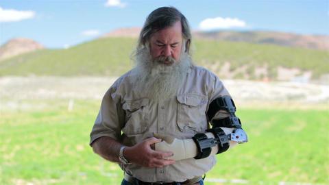 Mature man with beard arm brace after surgery HD 8225 Footage