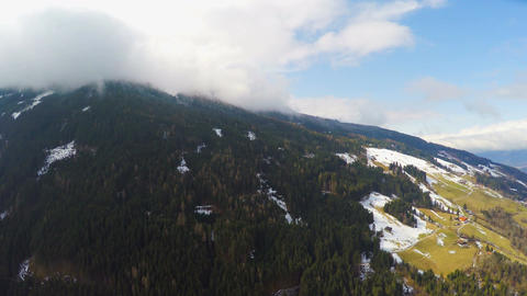 Austrian Alps, thick clouds over mountain peak, high humidity, weather Footage