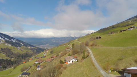Beautiful mountain landscape, houses on green slopes, small Alpine village Footage
