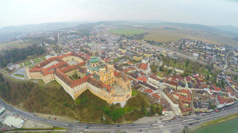 Benedictine abbey atop town of Melk, Austria. River Danube. View from above Live Action