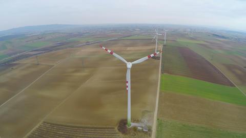 Top view of rotating wind turbines. Industrial wind power. Alternative energy Footage