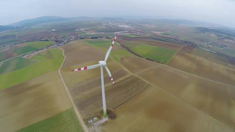 Panorama of wind turbine on green field in countryside. Energy self-sufficiency Footage
