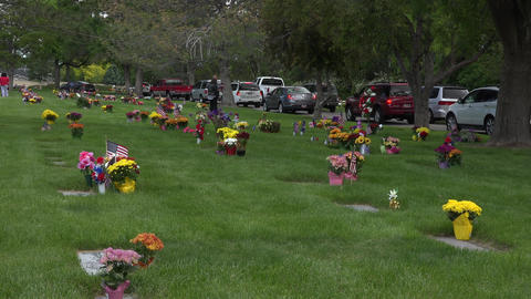 Memorial Day cemetery flowers busy traffic 4K 014 Footage