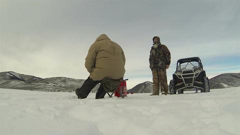 Men ice fishing winter mountain frozen lake HD 0230 Footage