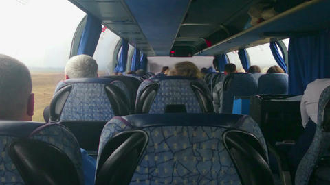 Tourist bus full of passengers. People traveling on a budget, in economy class Footage