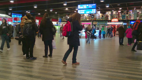 People in busy railway station. Passengers waiting for train, checking timetable Footage