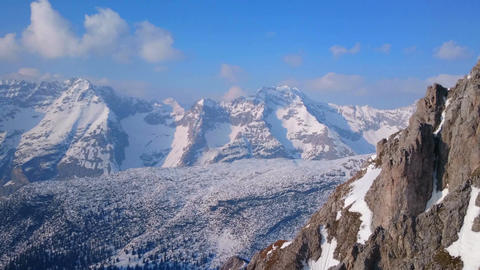 Horizontal panorama of wide mountain range in winter. Hills covered with snow Footage