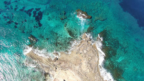 Top view of crystal clear water rolling on deserted rocky coast. Aerial view of Live影片