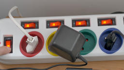 Hand is switching on power on the extension cord main switch Live Action