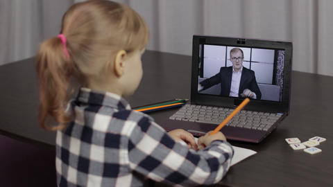 Children pupil distance education on laptop. Online lesson at home with teacher Live Action
