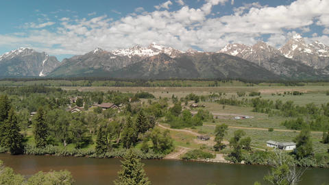 Panoramic aerial view of Grand Teton peaks, landscape and Snake River on a Live Action