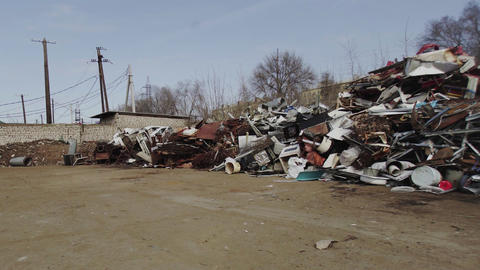 Metal Scrap. Waste Pile of Wasted Consumer Goods before Recycling Process Live Action