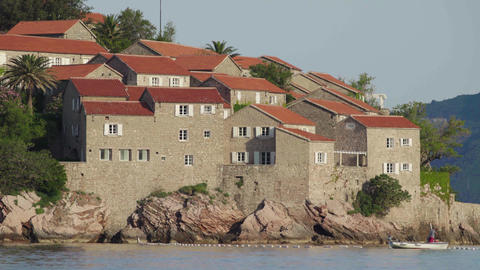 Houses with red tiled roofs. Architecture of Sveti Stefan. Montenegro Live Action