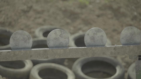 Iron targets during the shooting. Slow motion, Live Action