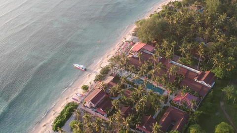 pink vanilla hotel among palm trees and pink boat gili air pink coco Live Action