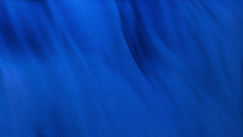 Seamlessly looping blue flag cloth in full frame with selective focus Animation