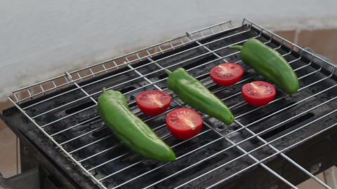 Tomatoes And Peppers Are Cooking On Coals In Grill. Outdoors Video With Sunshine Live Action