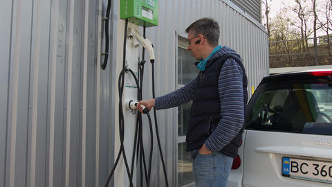 Ukraine. Lviv. 23 April 2020. A man who is charging his small car at an electric Live Action
