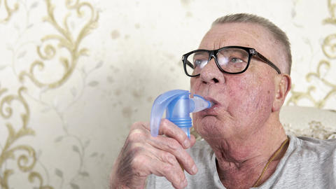 Old grandfather makes medical steam inhalations at home Live Action