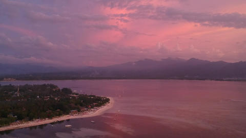 pink colorful sunset gili air indonesia on the background of the island of ライブ動画
