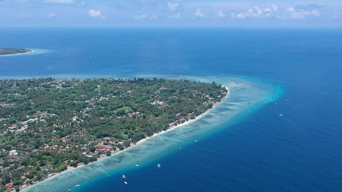 approaching gili air island in the ocean in sunny weather Live Action