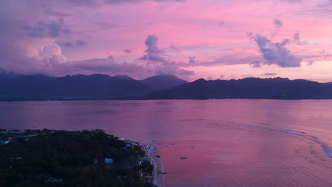 camera zooms in on a scenic sunset with mountains on the horizon gili air lombok Live Action